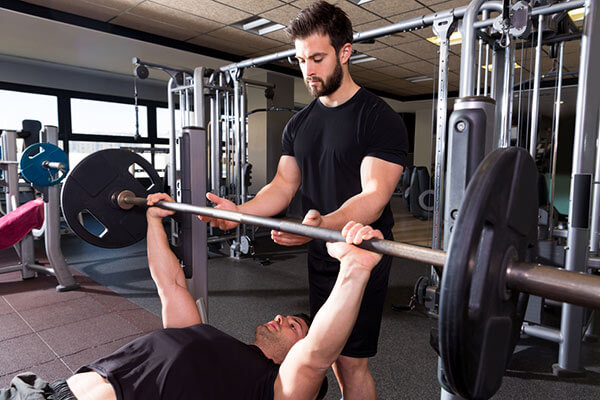 man bench pressing with a pre workout