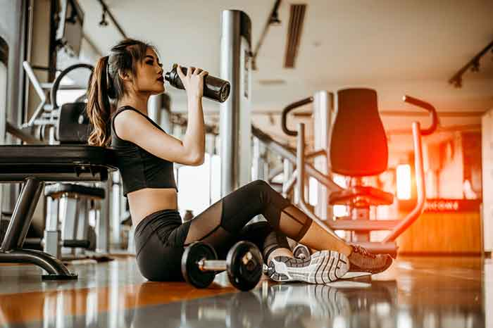 Taking on fluids during a home workout session